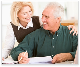 elderly couple going over their finances