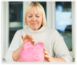 older woman holding a piggy bank