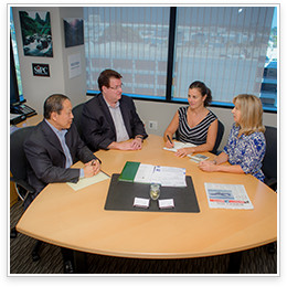 team of financial advisors around a table